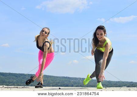 Sexy Women Athletes Do Exercises, Training. Women Training On Natural Landscape, Sport. Energy, Ener