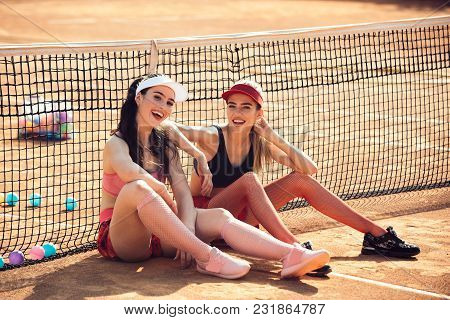 Wellness, Bodycare, Health, Healthcare. Women Athletes Relax On Tennis Court, Sport. Sport, Training