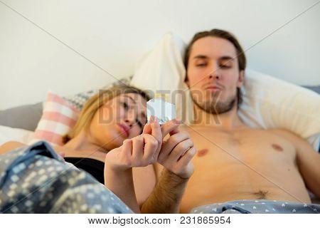 Safe Sex Concept - Woman Holding A Condom