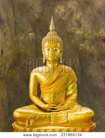 Old Golden Buddha Statue In Meditation At Cave