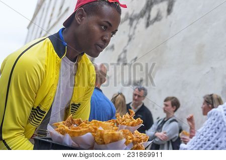 Havana, Cuba - January 04, 2018: A Black Young Man Sells Chips On Havana Street In Cuba