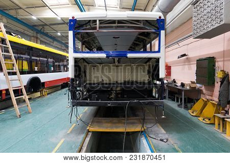 One Working Day Of Modern Automatic Bus Manufacturing With Unfinished Cars Workers In Protective Uni
