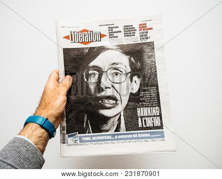 Paris, France - Mar 19, 2018: Man Reading French Liberation Newspaper With Portrait Of Stephen Hawki