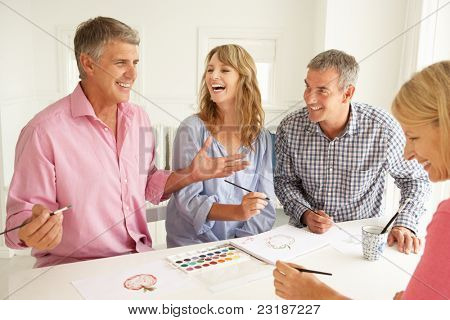 Mid age couples painting with watercolors