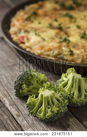 Fresh Vegetable Pie Served On A Cutting Board On Rustic Wooden Table. Selective Focus On The Broccol