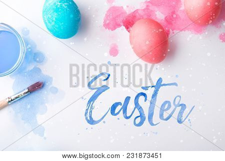 Easter Phrase And Colored Eggs On A White Background. Studio Shot. Flat Lay.