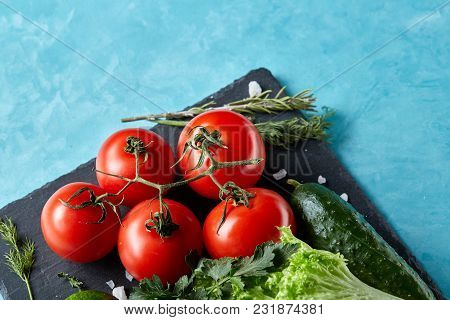 Refreshing Seasoning Close-up Still Life Of Assorted Fresh Vegetables And Herbs On Blue Background,