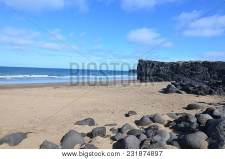 Pretty Shoreline With Yellow Sand Beach In Iceland