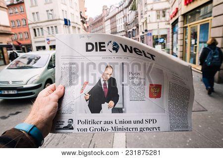 Paris, France - Mar 19, 2017: Man Reading Buying German Die Welt Newspaper At Press Kiosk Featuring