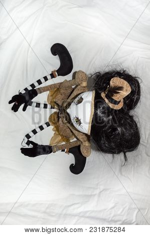 Creepy Steampunk Rag Doll Posed In A Sitting, Kneeling Position Looking Left, Viewed From Above. Lif