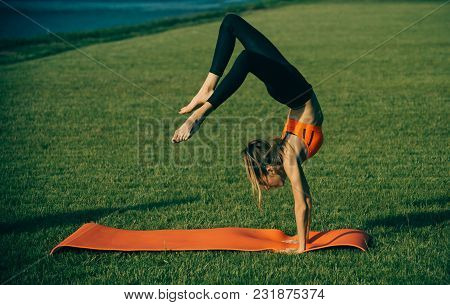 Activity, Energy, Energetic. Woman Sportswoman Training On Green Grass, Sport. Sport, Yoga, Pilates,