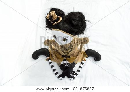 Creepy Steampunk Rag Doll Posed In A Sitting, Kneeling Position Looking Left. High Angle View. Lifes