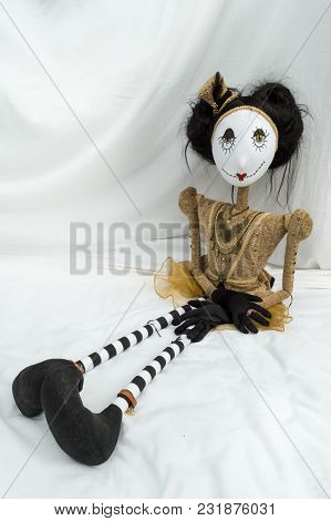Creepy Steampunk Rag Doll Sitting With Legs Outstretched. Looking Forward. Lifesize Doll On A Grungy