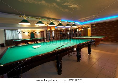 Billiard tables in a fashionable night club poster