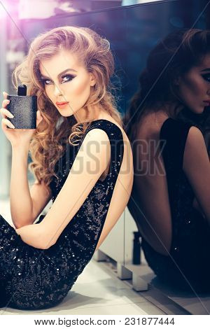 Fragrance, Aroma, Scent, Perfume, Perfumery, Cologne, Cosmetics. Woman In Sexy Dress With Perfume Bo