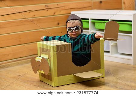 Little Boy Child Play In Cardboard Plane, Childhood. Kid, Pilot School, Innovation. Dream, Career, A