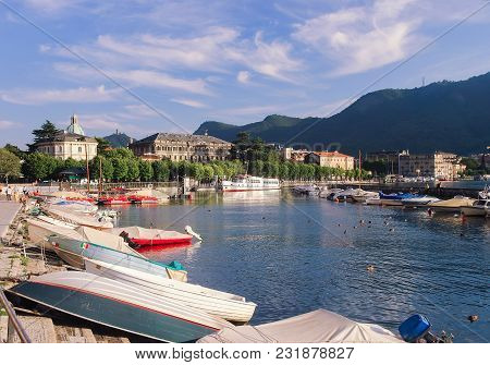 Pier With Boats In A Mountain Lake Como, Italy At Sunny Summer Day