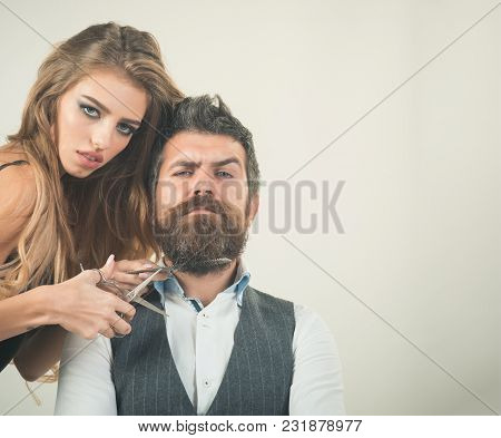 Couple In Love At Hairdresser. Bearded Man And Sexy Woman With Long Curly Hair. Couple Make Haircut,