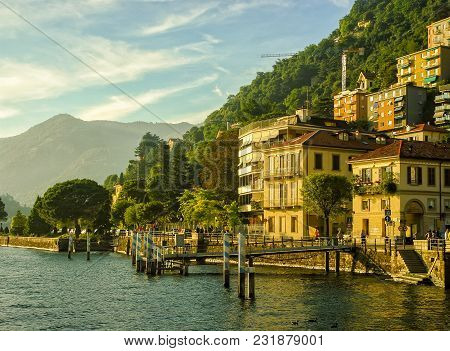 View Of Buildings In Como From Coast Como Lake, Italy At Sunny Summer Day