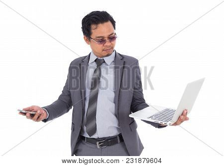 Business Man Holding Mobile Phone And Laptop Isolated On White Background