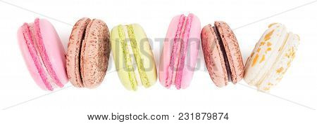 A French Sweet Delicacy, Macaroons In Row. Isolated On White Background. Top View.