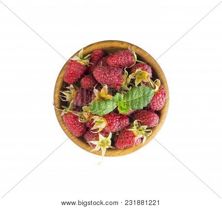 Raspberries In A Wooden Bowl Isolated On White Background. Raspberry Close-up. Vegetarian Or Healthy