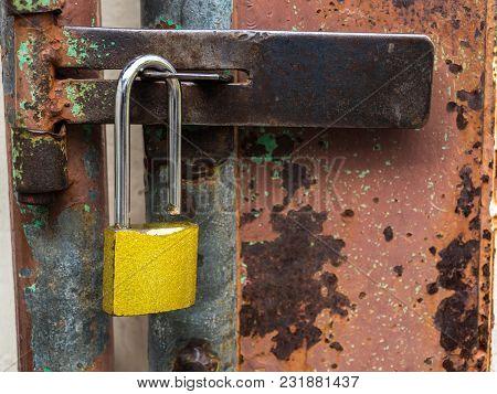 Golden Lock At The Rusted Steel Door.
