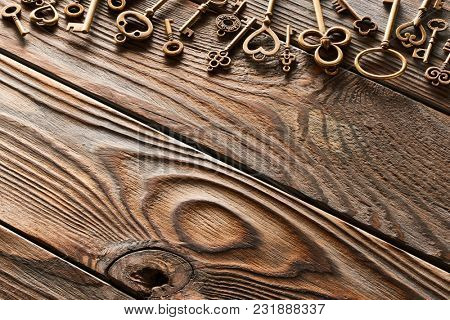 Various metal keys over wooden background