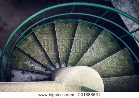 Concrete Spiral Staircase. View From Above. City Architecture