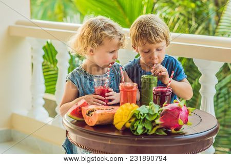 Children Drink Colorful Healthy Smoothies. Watermelon, Papaya, Mango, Spinach And Dragon Fruit. Smoo