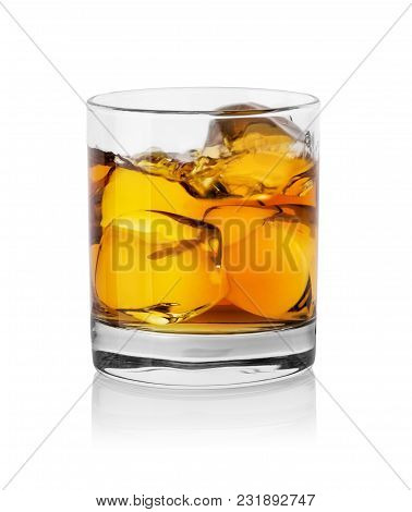 Glass With Whiskey And Ice Cubes Isolated On White Background