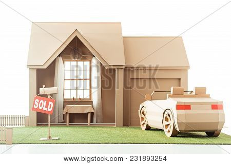 Cardboard House And Car With Sign Sold Isolated On White