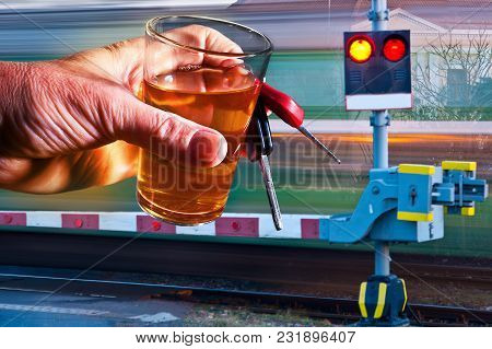 Driver Holding Glass Of Spirit And Car Key