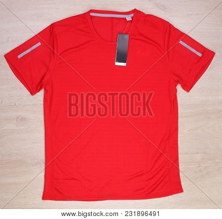 Red Running T-shirt With Label On Wooden Background, Red Sport Shirt