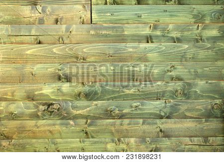 Texture of ancient wood with cracked paint of green color