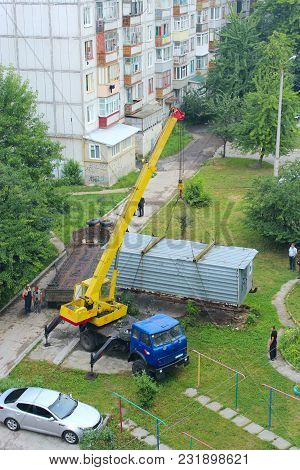 Chernihiv / Ukraine. 28 May 2015: Industrial Crane Lift Up Container Box To Load It Onboard Truck. C