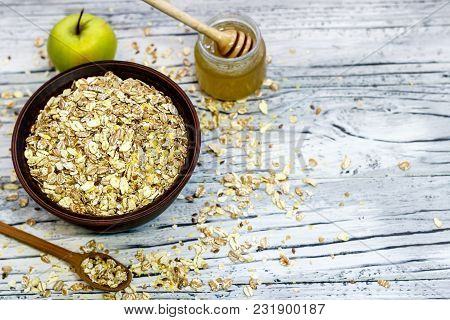 Plate With Muesli On A Wooden Background Near Apples And Honey. Healthy Breakfast. View From Above.