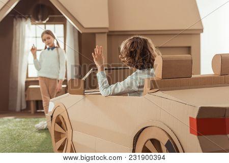 Little Kid Arrived For Girlfriend On Cardboard Car