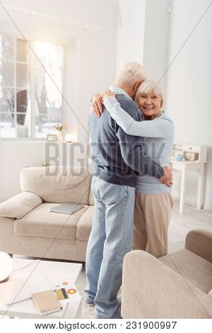 Hold Me Close. Happy Elderly Woman Posing For The Camera During The Dance With Her Husband While Hug