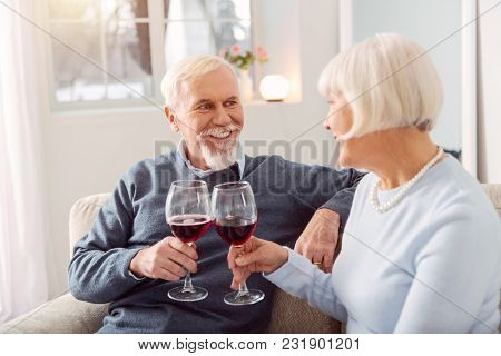 Long Time Together. Happy Senior Couple Celebrating Their Wedding Anniversary And Drinking Wine Whil