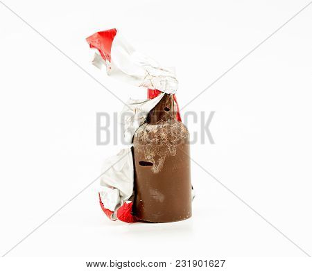 Bottle Like Candy With Sweet Cherry,chocolate And Syrup Liquors On A White Background.