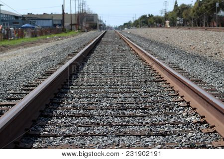 Train Railroad Tracks At A Poor Neighborhood