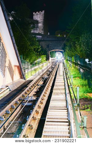 Funicular Ride, Rails And Tunnel En Route Within Tunnel With Lights And Light Trails From Distant En