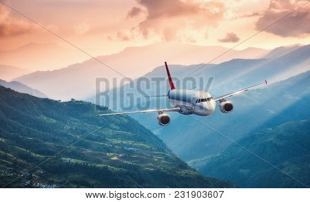 Aircraft Is Flying Over Green Hills Against Mountains
