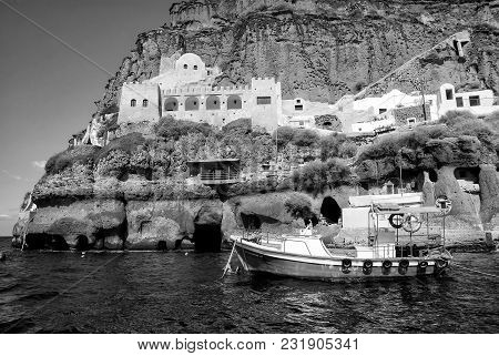 Santorini, Greece - July 15, 2017: Sailing Boat In Bay Of Santorini Island On Water Near Building On