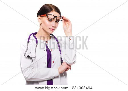Portrait Of Young Attractive Positive Woman Doctor Standing In Office Waiting For Patient Looking In