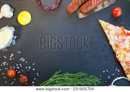 Background. Black Slate With Pizza, Vegetables, Food Spice And Herbs.