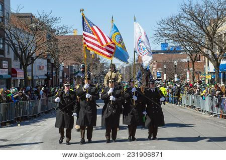BOSTON, USA - Mar. 18, 2018: Military March in Saint Patrick's Day Parade in Boston, Massachusetts, USA.