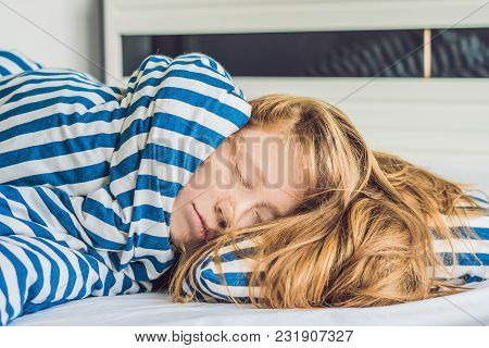 Beautiful Young Woman Lying Down In Bed And Sleeping. Do Not Get Enough Sleep Concept.