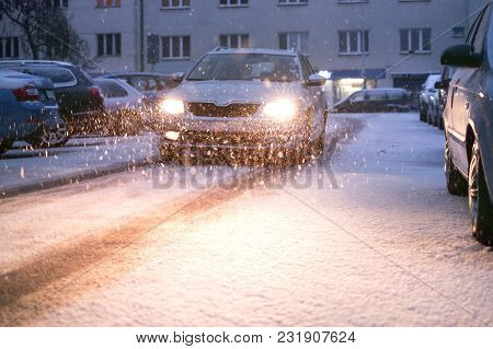 Prague City Street Under The Snow. Cars Driving On A Blizzard Road. Snow Calamity In The City. Snow